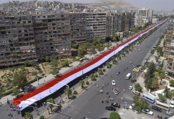 Vlajka podpory Asadovi v roku 2011