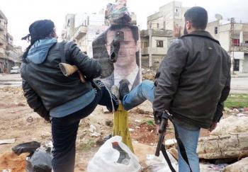 Rebeli ničia portrét sýrskeho prezidenta