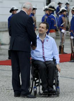 Slovenský prezident Ivan Gašparovič a vpravo predseda Slovenského paralympijského výboru Ján Riapoš