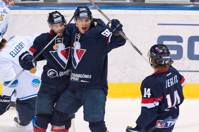 Na snímke hráči Slovana sprava Žiga Jeglič, Andrej Šťastný a Rok Tičar sa tešia po strelení gólu v zápase hokejovej KHL Slovan Bratislava - Barys Astana