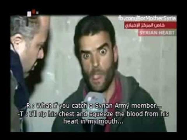 """Sýrsky rebel pod vplyvom drogy, ktorý redaktorovi hovorí, čo urobí sýrskemu vojakovi, keď ho dolapí: """"Otvorím mu hrudník a ústami mu vysajem krv zo srdca..."""""""