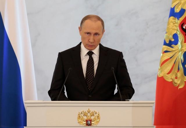 Na snímke ruský prezident Vladimir Putin počas výročného prejavu o stave krajiny k poslancom oboch komôr Federálneho zhromaždenia v Kremli v Moskve