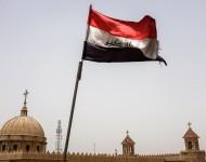 Kresťanská katedrála v Kirkúku a roztrhaná iracká vlajka