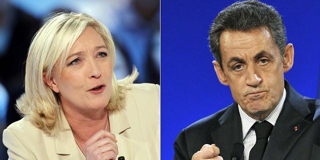 Na snímke Marine Le Penová a Nicolas Sarkózy