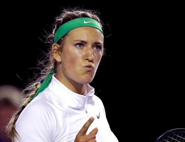 Na snímke bieloruská tenistka Victoria Azarenková sa raduje z víťazstva proti Belgičanke Alison Van Uytvanckovej v 1. kole dvojhry na grandslamovom turnaji Australian Open