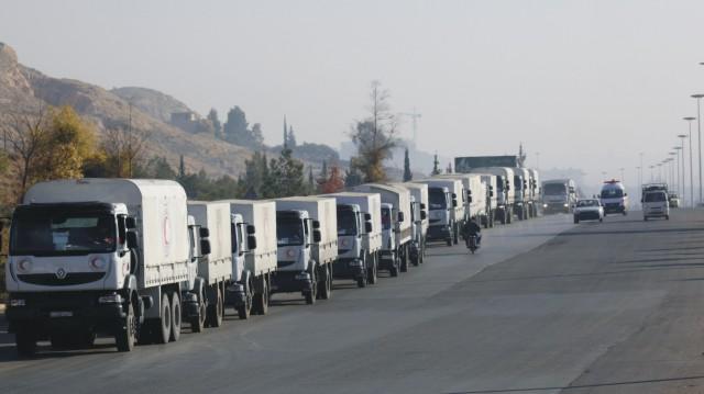 Konvoj vozidiel s humanitárnou a ostatnou pomocou Medzinárodného výboru Červeného kríža smeruje do obliehaného sýrskeho mesta Madájá