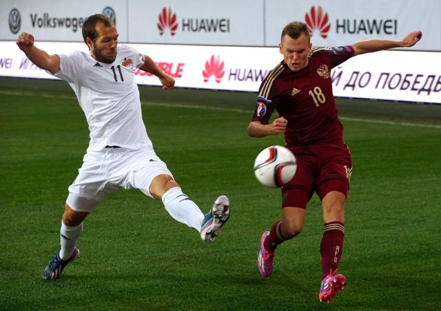 Na snímke vpravo Denis Čeryšev