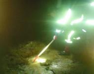Na snímke miestny dobrovoľný hasič počas zásahu v obci Paňovce
