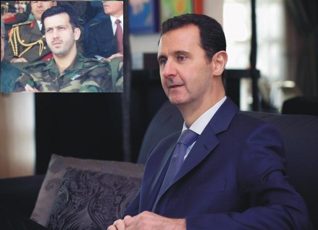 Na snímke sýrsky prezident Bašár Asad a vľavo v rohu jeho brat Masura Asad
