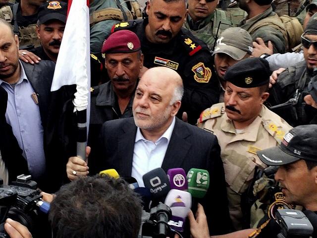 Iracký premiér Hajdar Abádí (uprostred)