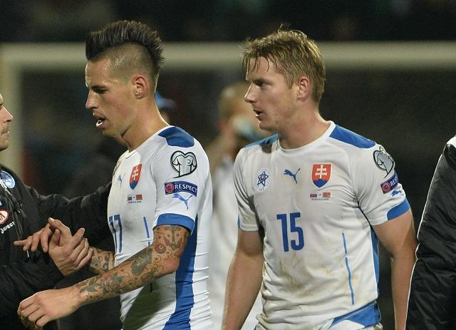 Na archívnej snímke slovenskí futbalisti Marek Hamšík ( zľava) a Tomáš Hubočan