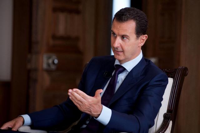 Na snímke sýrsky prezident Bašár Asad Foto.TASR-SANA via AP