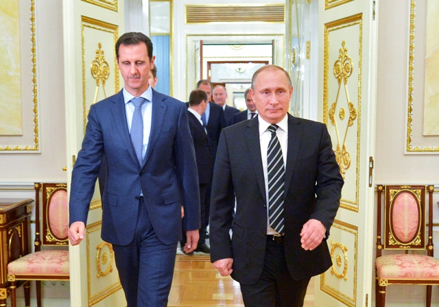 Na snímke sýrsky prezident Bašár Asad (vľavo) a ruský prezident Vladimir Putin Foto:TASR-Alexei Druzhinin, RIA-Novosti, Kremlin Pool Photo via AP