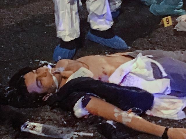 Na snímke telo Tunisana Amriho leží na zemi po streľbe s talianskymi policajtami na predmestí Milána