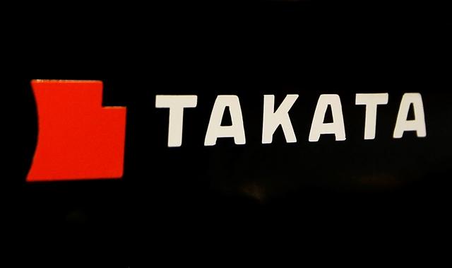 Na snímke logo producenta autokomponentov Takata v Tokiu
