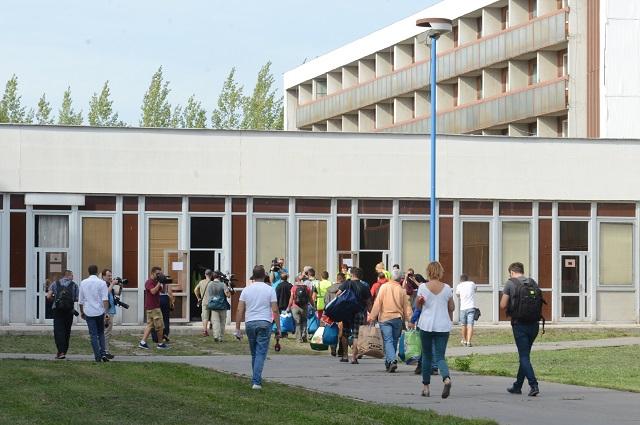 Ilustračné foto: Na snímke príchod žiadateľov o azyl do Gabčíkova