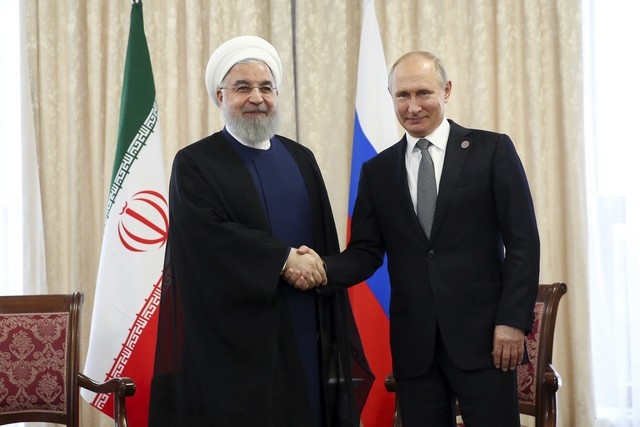 48e9bd5fad Na snímke iránsky prezident Hasan Rúhání (vľavo) a ruský prezident Vladimir  Putin